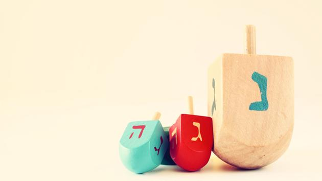 The Physics of a Hanukkah Dreidel